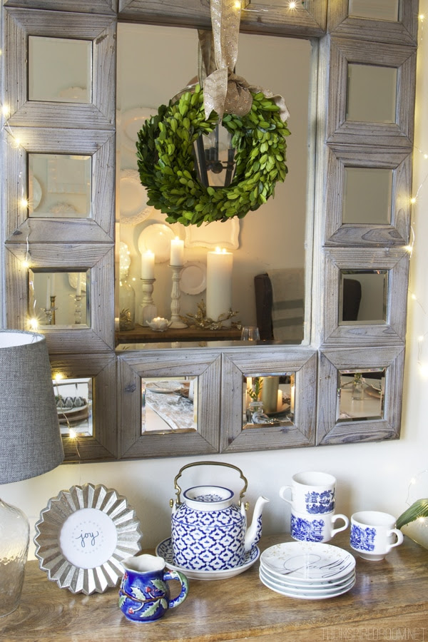 Boxwood wreath hung on a mirror - Dining room Christmas decorating - The Inspired Room