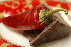 Chilli Peppers and Dark Chocolate on Red