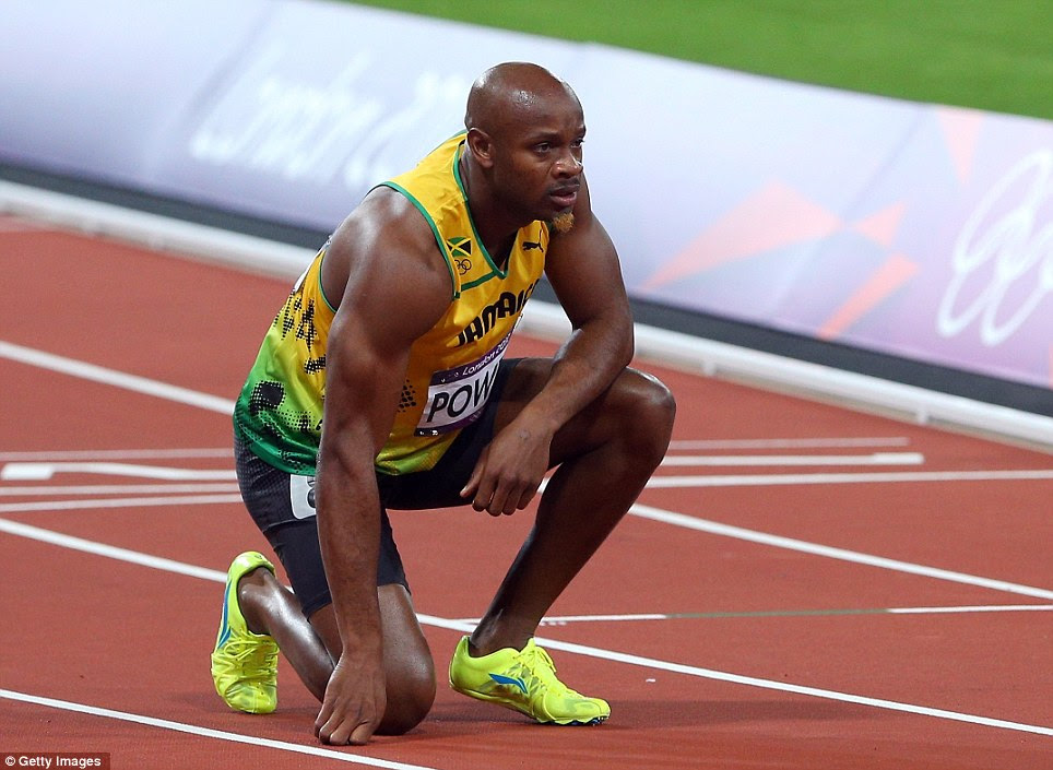 Out of contention: Usain Bolt's Jamaican team-mate Asafa Powell, who pulled up injured during the race, looks forlorn after finishing eighth