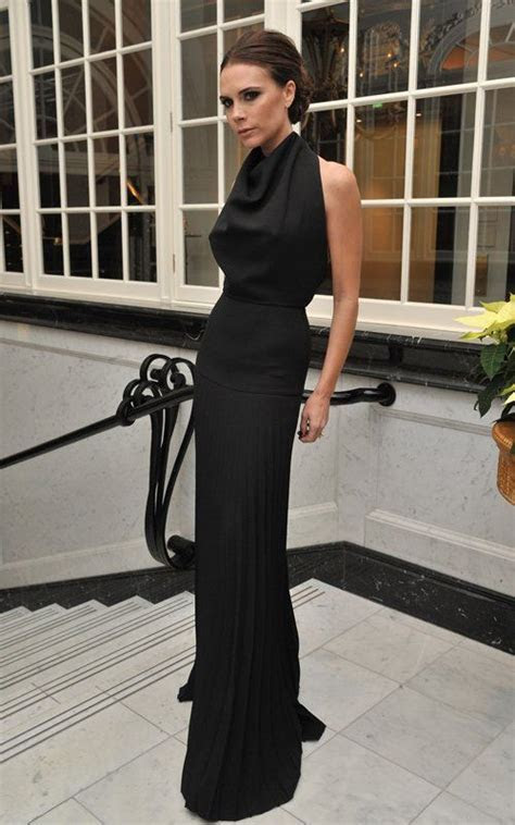 Victoria Beckham. Love her designs. But she must smile