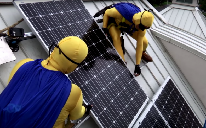 Solar installers dressed up as superheroes to complete the installation on the KidsQuest Children's Museum in Washington as part of the Solarize Bellevue campaign. Photo by Allison DeAngelis.