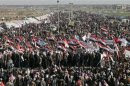 Iraqi Sunni Muslims wave the old flag of Iraq during an anti-government demonstration in Ramadi