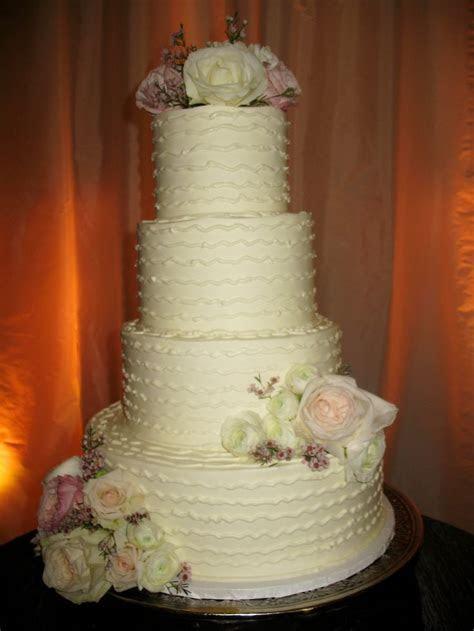 white wedding cake www.cheesecakeetc.biz wedding cakes