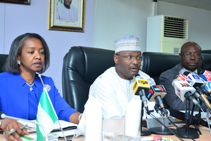 INEC Chair Mahmood Yakubu (centre) with National Commissioners, Mrs May Agbamuche-Mbu (left) and Barrister Festus Okoye (right)