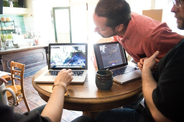 SkyTruth members, from left, David Manthos, John Amos and Paul Woods huddle around their computers during a meeting at Mellow Moods Cafe in Shepherdstown, W.Va., in April.