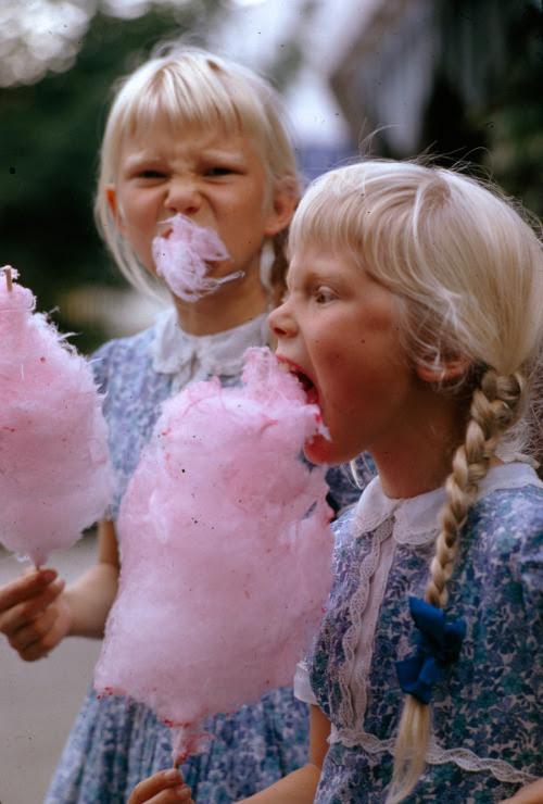 natgeofound:  Girls eat large swirls of cotton candy in Copenhagen, Denmark, January 1963.Photograph by Gilbert M. Grosvenor, National Geographic