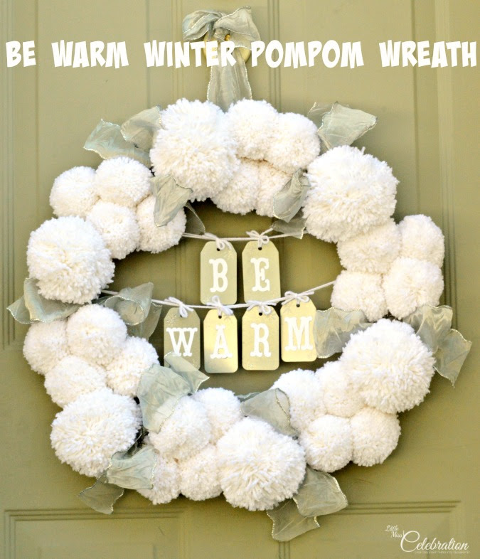 Make a big, fluffy Be Warm Winter Pompom Wreath to welcome family and friends during the cold & frosty winter months! At littlemisscelebration.com #crafts #winter