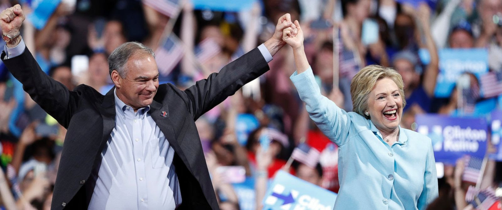 PHOTO: Democratic presidential candidate Hillary Clinton arrives with Sen. Tim Kaine, at a rally at Florida International University Panther Arena in Miami, July 23, 2016.