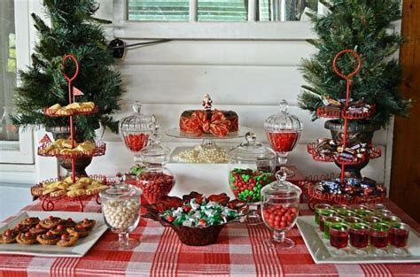 Red and white christmas dessert buffet. Candy jars,red