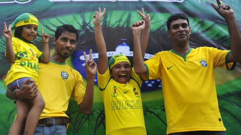 Football fans take out a procession on Dhaka University campus ahead of the opening ceremony eve of 20th FIFA World Cup 2014 that will take place in Brazil.