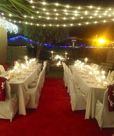 Formal sit down dinner holiday party in back yard