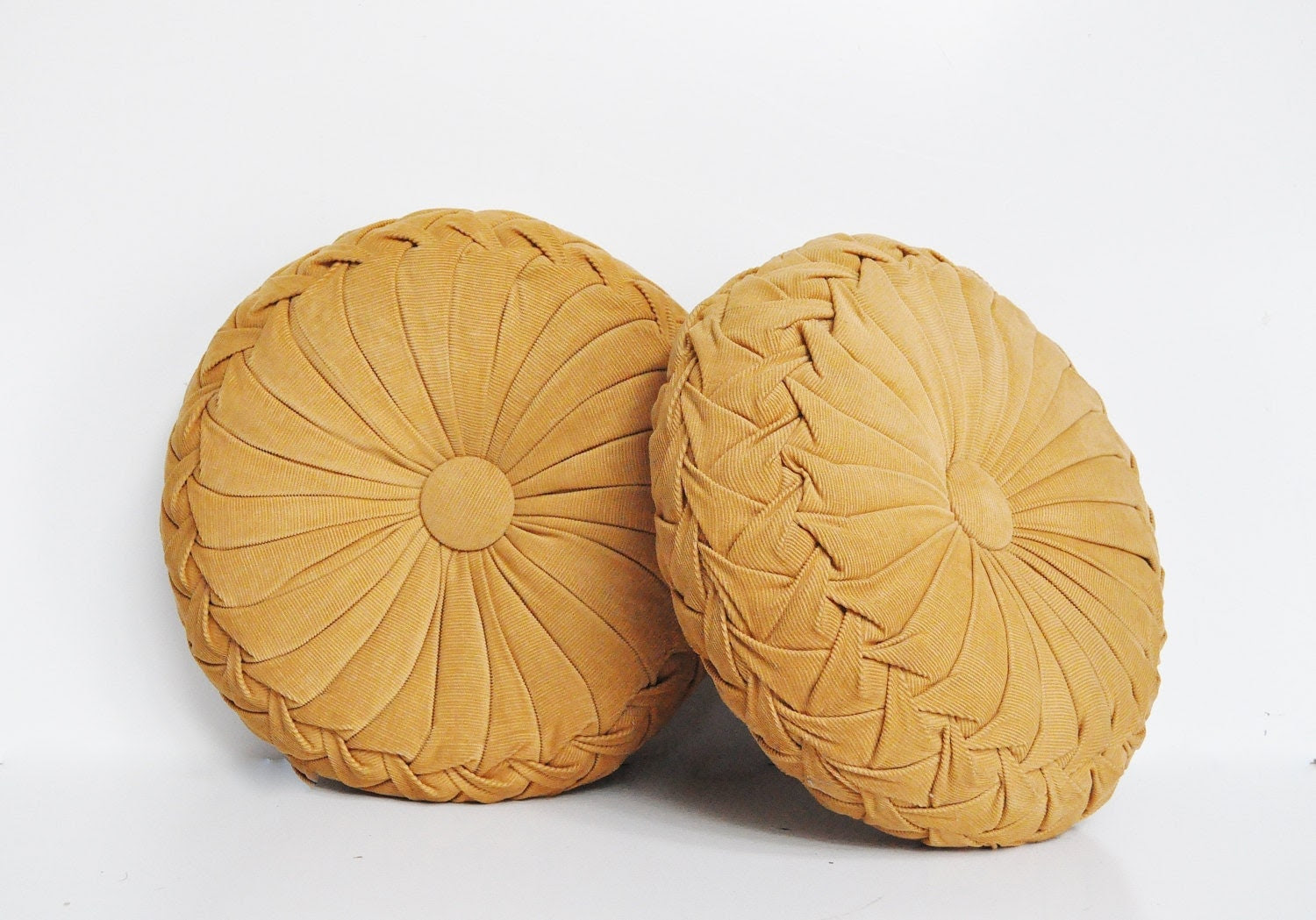 Pair of Vintage Smocked Pillows Round Pillows by thewhitepepper