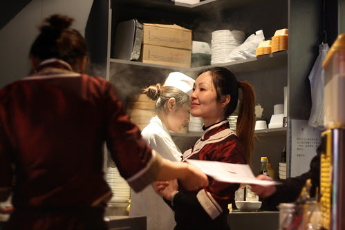 Leong's Legends smiling waitress