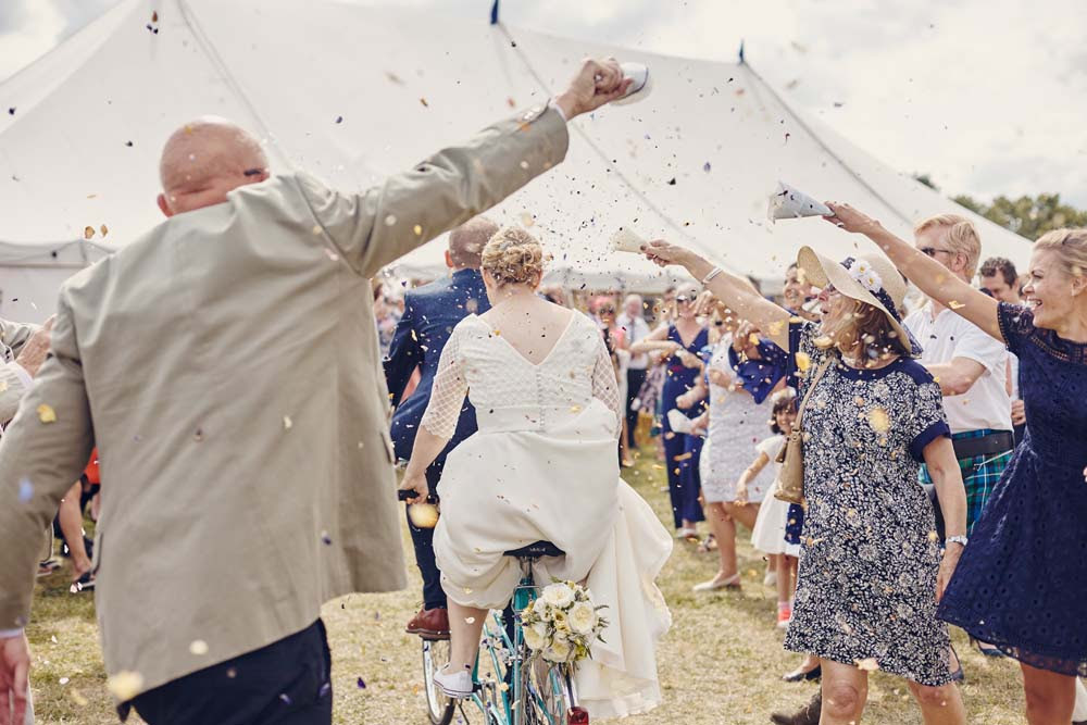 Bride and Groom arrive on Tandem with Confetti aisle - www.helloromance.co.uk