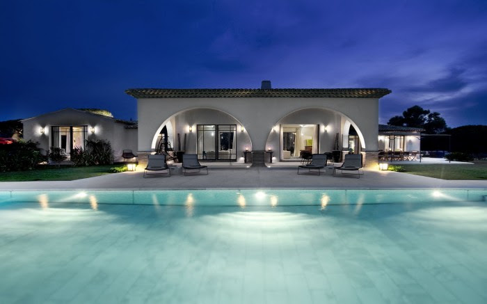 arched pool house at night