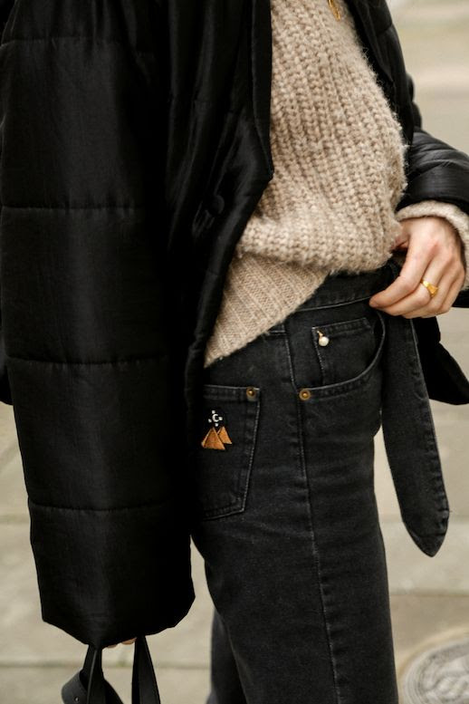 Le Fashion Blog Black Bomber Jacket Neutral Sweater Tie Front Black Jeans Casual Outfit Via Fashion Me Now