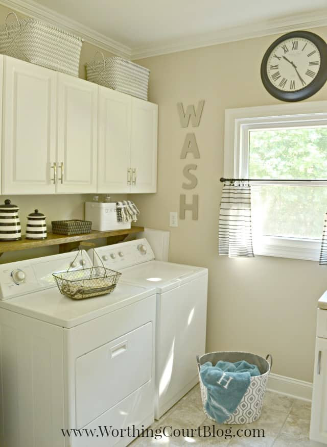 Laundry room with farmhouse and rustic touches