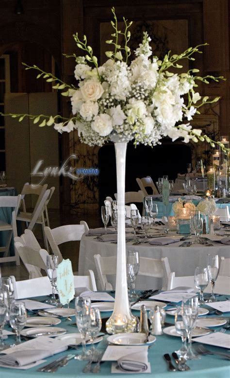 Guest table centerpiece on Eiffel Tower vase with white