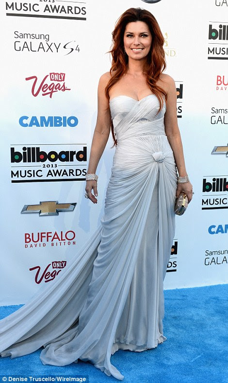 I feel like a woman: Newly red-haired Shania Twain, 47, looked like a silver-hued goddess in her bandage-style Pavoni by Mikael D gown