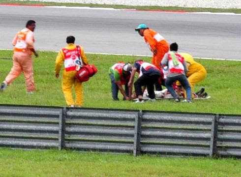 http://i.usatoday.net/sports/_photos/2011/10/23/Italys-Marco-Simoncelli-dies-in-MotoGP-race-6SGNCTT-x-large.jpg