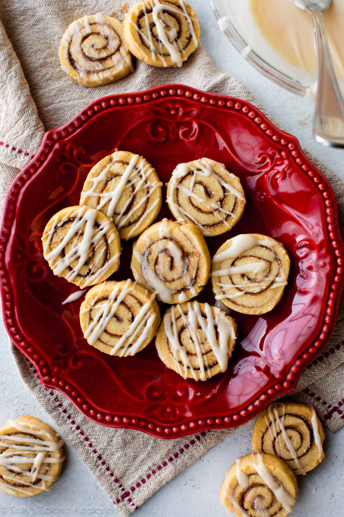 Little cinnamon roll cookies made from sugar cookie dough! Easy recipe on sallysbakingaddiction.com