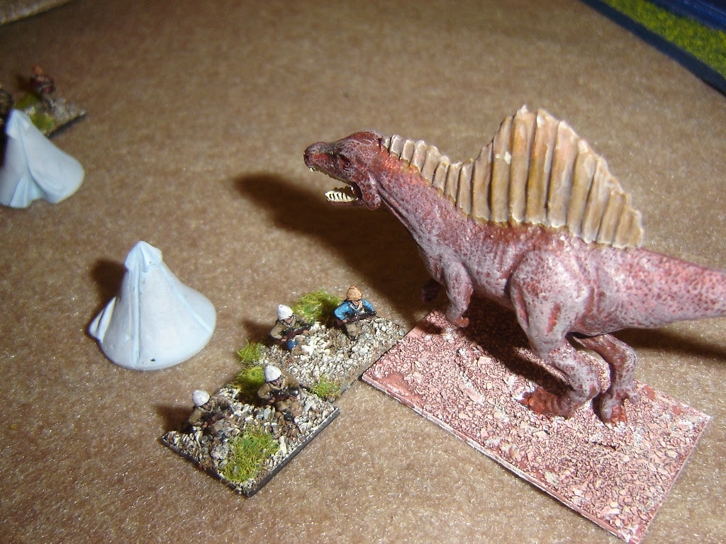 Spinosaurus charges into camp