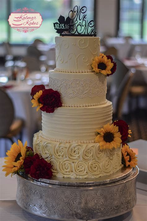 Fall buttercream wedding cake with sunflowers, lace, and