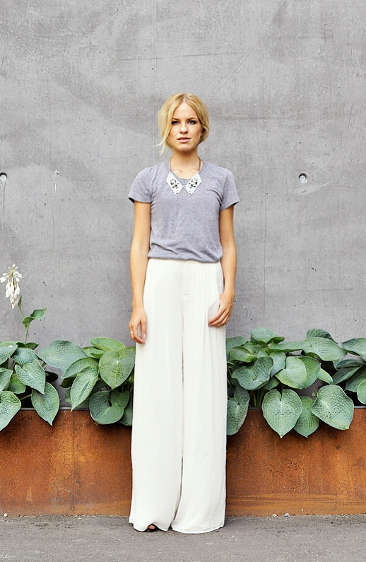 LE FASHION BLOG STREET STYLE BLOGGER STYLE MY BLOMQUIST TEE NECKLACE WHITE PANTS GINA TRICOT CLEAR TRANSPARENT PLASTIC JEWELED COLLAR NECKLACE AMERICAN APPAREL HEATHER GRAY TEE TSHIRT ZARA WHITE WIDE LEG CREPE WASHED SILK TROUSER PANTS BLONDE HAIR CONCRETE WALL BACKGROUND 1 photo LEFASHIONBLOGSTREETSYLEBLOGGERSTYLEMYBLOMQUISTTEENECKLACEWHITEPANTS1.png