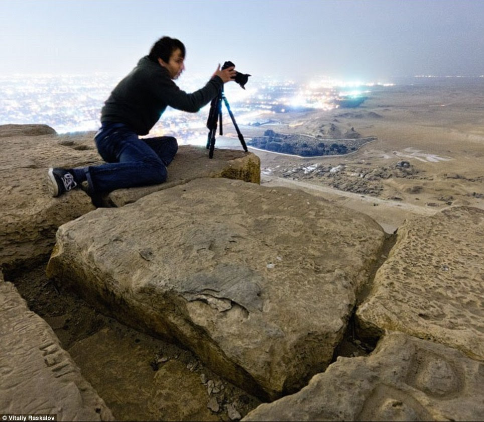Perch: The photographer set up a tripod on one of the giant stone slabs at the top of Egypt's world-famous Great Pyramid