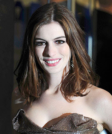 catwoman costume anne hathaway. GOOD KITTY: Anne Hathaway will