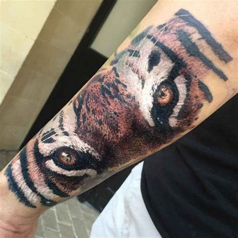 eyes  tiger tattoo  forearm animals tattoo