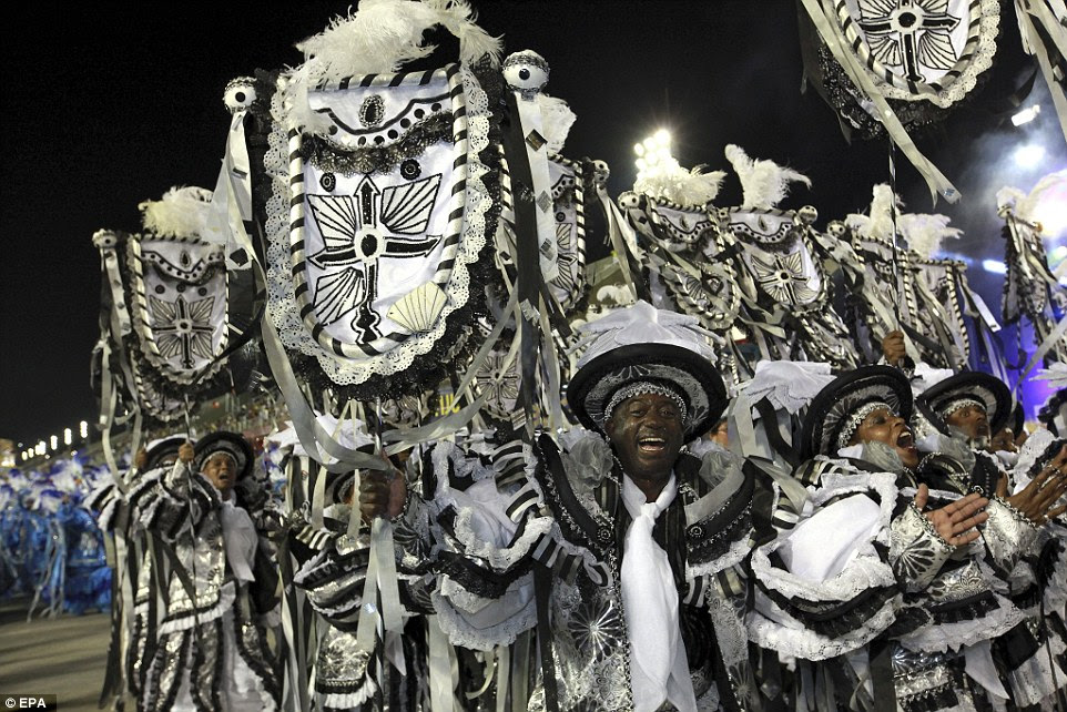 Wearing bold black and white costumes, these revellers were among those to take part in the two-day samba parade in Rio