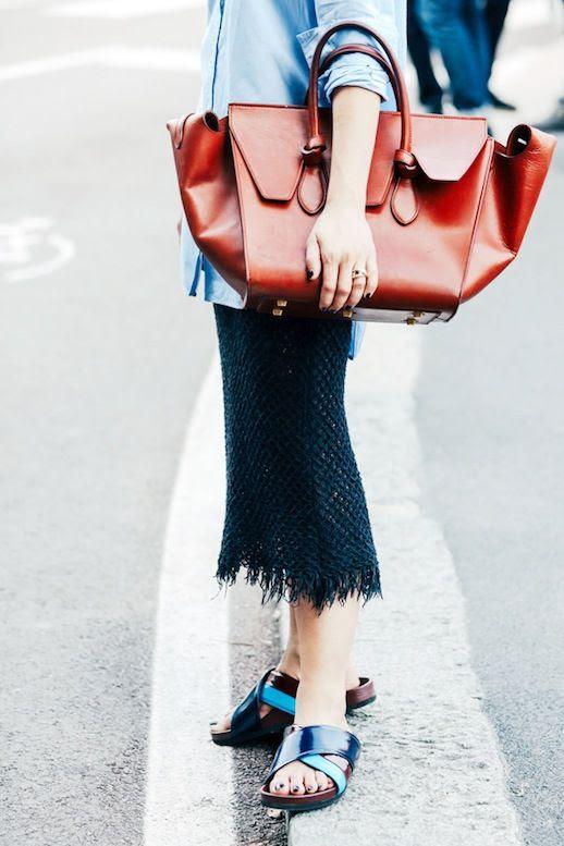 Le Fashion Blog Casual Street Style Blue Button Down Shirt Oversized Celine Bag Fringed Hem Skirt Slide Sandals Via Vogue Paris