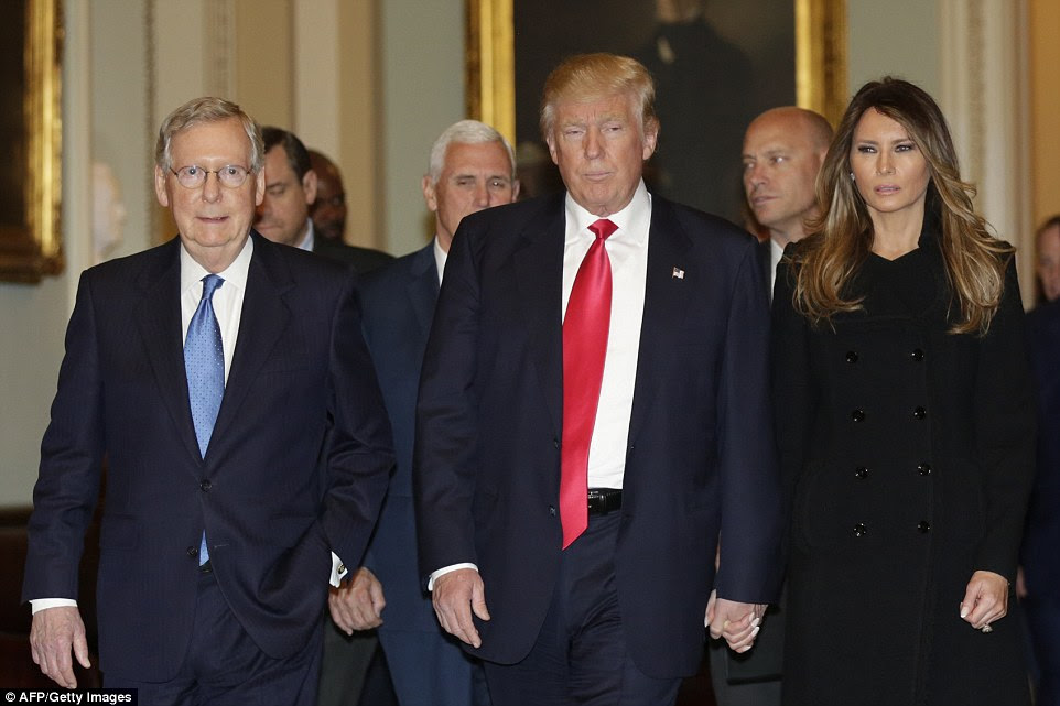 Trump and Melania walked hand in hand as they followed McConnell to a meeting on Capitol Hill Wednesday afternoon