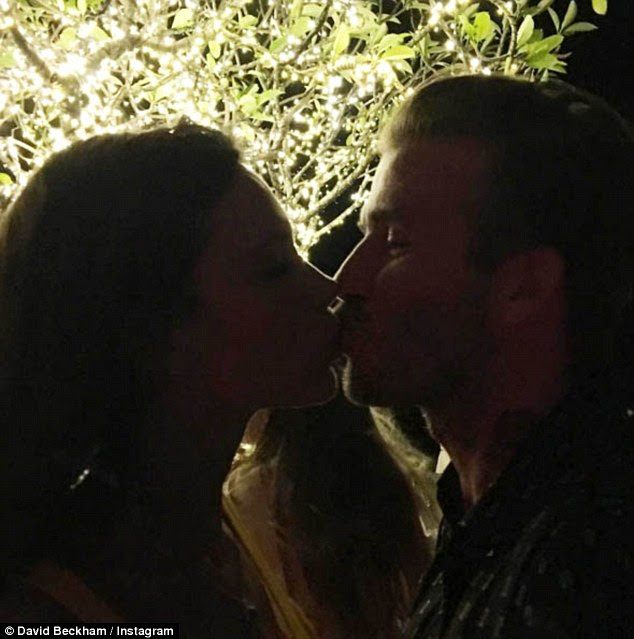 Besotted: David and Victoria Beckham prepared to ring in the New Year as the retired footballer shared a sweet PDA snap of the two of them on Instagram