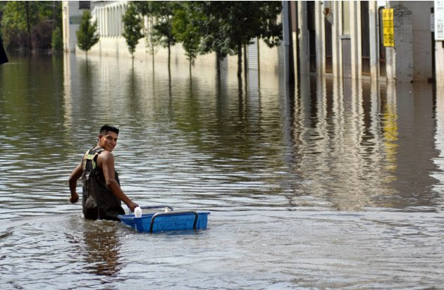 A worker retrieves items from a factory in the flood waters of the Passaic River days after the passing of Hurricane Irene in Paterson