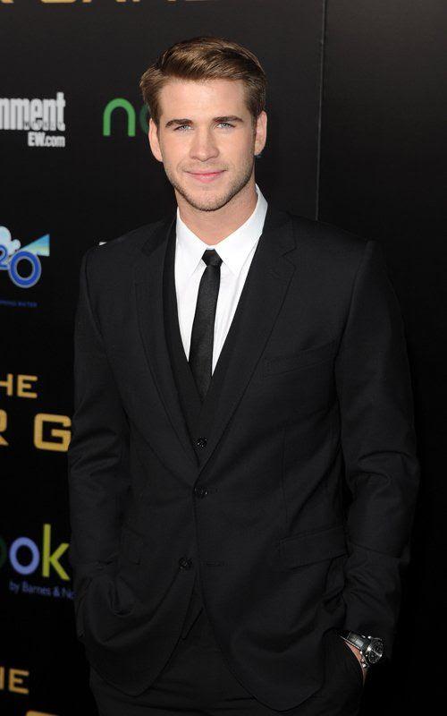 The Hunger Games - LA Premiere - March 12, 2012, Miley Cyrus, Liam Hemsworth
