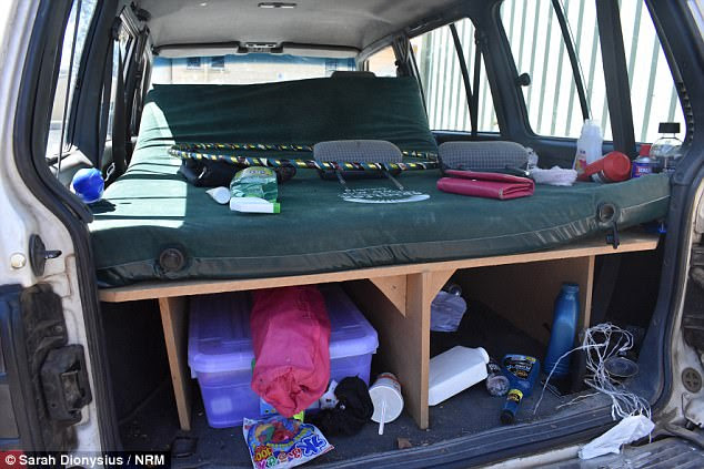 The inside of the 4WD is pictured here on Tuesday being held by police