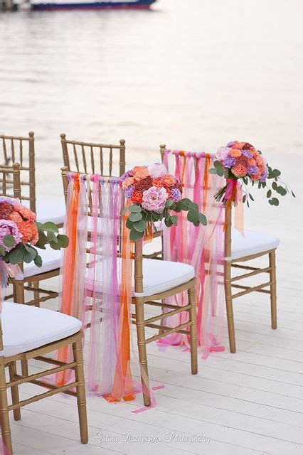 Wedding Ceremony chairs with brightly colored ribbons