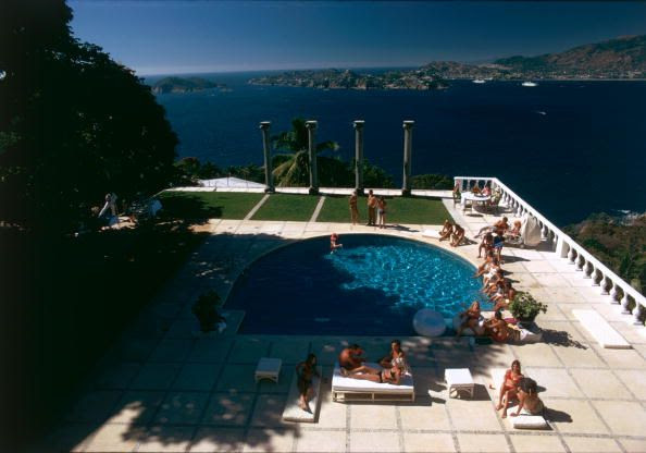 Title:Nirvana   Caption:The pool at Villa Nirvana, Acapulco, Mexico. Old Acapulco can be seen across the bay.       Artist:Slim Aarons  Date:Circa: 1971