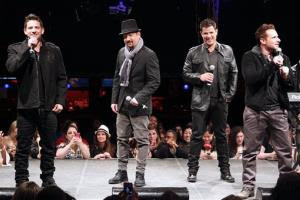 In this picture provided by Starpix, from left, Jeff Timmons, Justin Jeffre, Nick Lachey, and Drew Lachey of 98 Degrees perform during the announcement of The Package Tour, Tuesday, Jan. 22, 2013 in New York. The major summer tour will feature New Kids on the Block, 98 Degrees and Boyz...