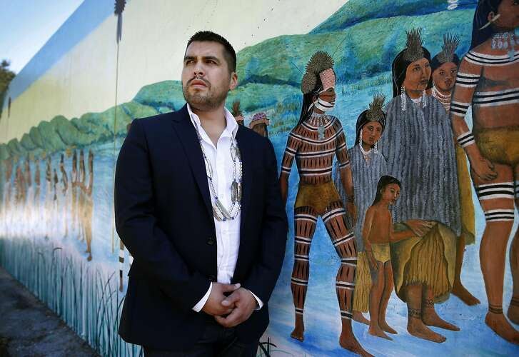 Vincent Medina visits a mural by artist Jean LaMarr which celebrates the history and culture of Ohlone Indians, at Ohlone Park in Berkeley, Calif. on Thursday, Sept. 17, 2015. Medina was chosen to read a passage in the Ohlone language of Chochenyo during the canonization ceremony of Junipero Serra by Pope Francis next week in Washington, D.C.