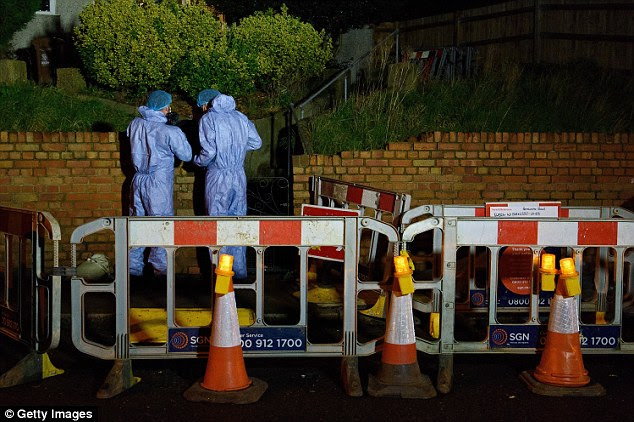 Shut: A path running outside the family home in Erith was cordoned off tonight as forensics continued working