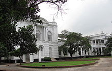 Large white building, with many pillars