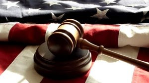 stock-footage-gavel-and-american-flag-gavel-strikes-wooden-base