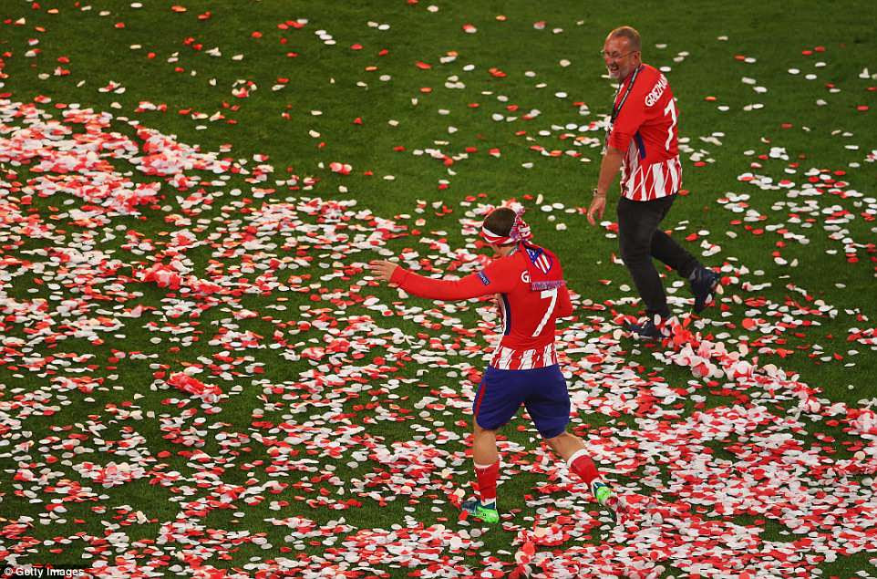 Griezmann enjoys a lap of honour amid the confetti as Atletico  celebrate their Europa League triumph on Wednesday