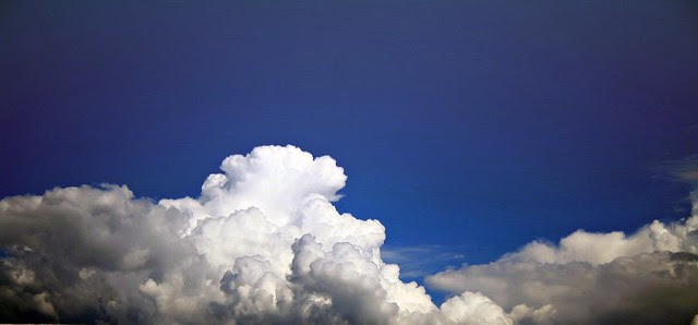 When clouds appear like rocks and towers, the earth's refreshed by frequent showers.