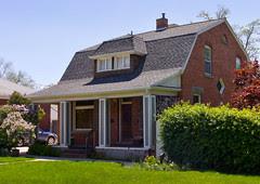 Brick Gambrel Roof House