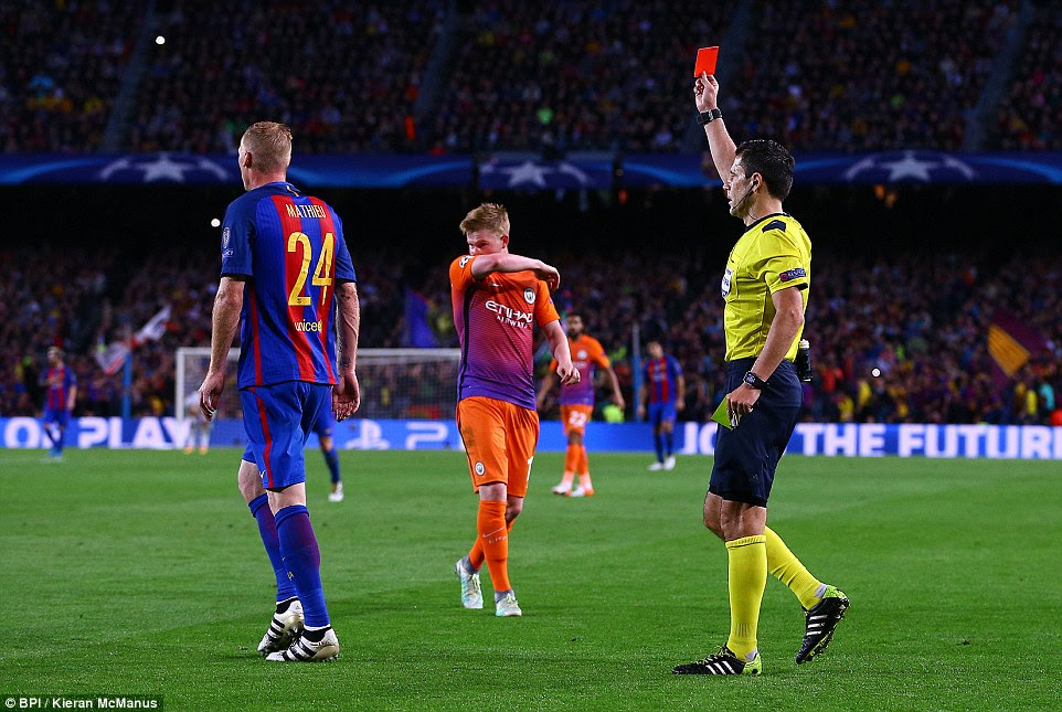 Despite Barcelona's dominance now, they too were reduced to 10 men when Jeremy Mathieu (left) was sent off
