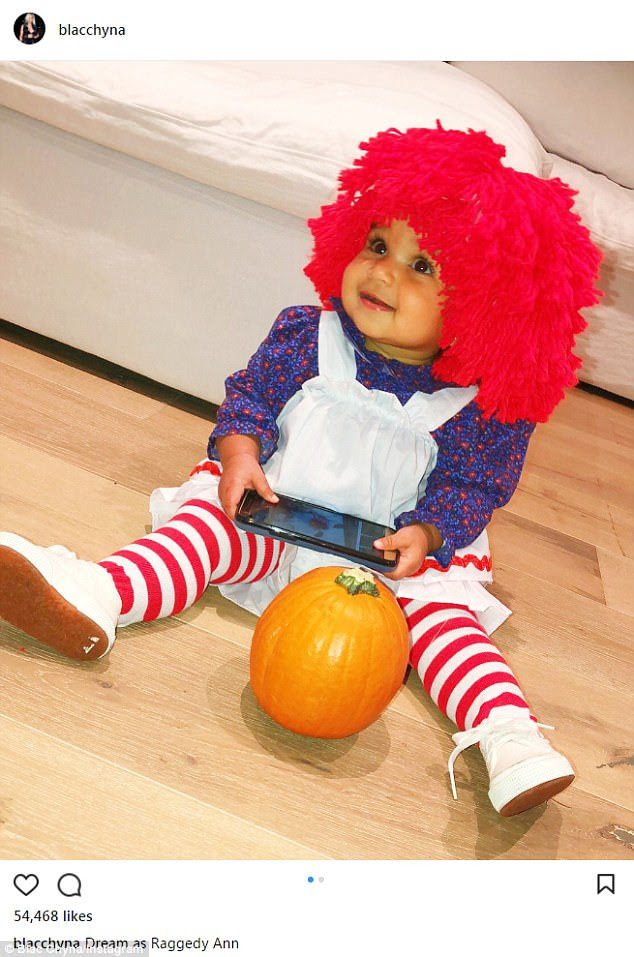 Cutie! Blac Chyna posted an adorable snap of baby Dream Kardashian, 11 months, dressed in a Raggedy Ann costume as the family celebrated Halloween on Tuesday